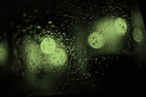 Rainy glass with green hue